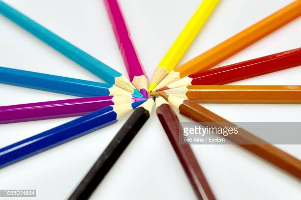 High Angle View Of Colored Pencils Over White Background