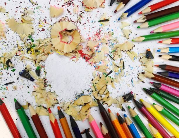 High Angle View Of Colored Pencils With Shavings On Table