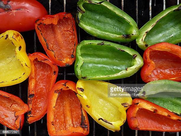 High Angle View Of Colorful Bell Peppers On Barbecue