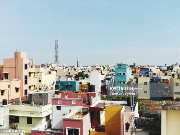 high angle view of colorful buildings in town against sky - chennai stock pictures, royalty-free photos & images