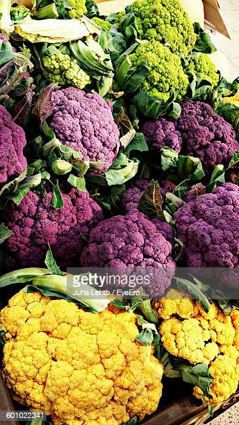 High Angle View Of Colorful Cauliflowers At Market