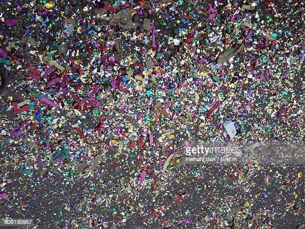 High Angle View Of Colorful Confetti On Floor