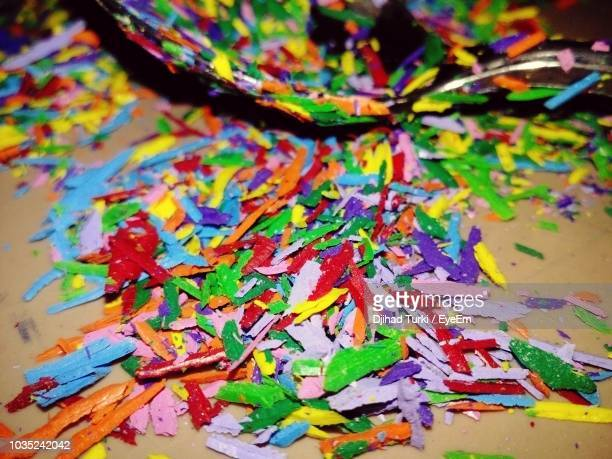 High Angle View Of Colorful Crayons Shaving On Table