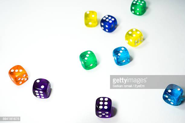 High Angle View Of Colorful Dice Against White Background