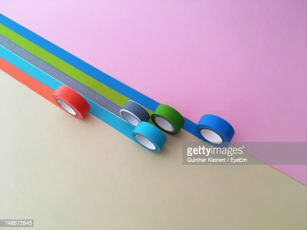 High Angle View Of Colorful Duct Tape Rolls On Table