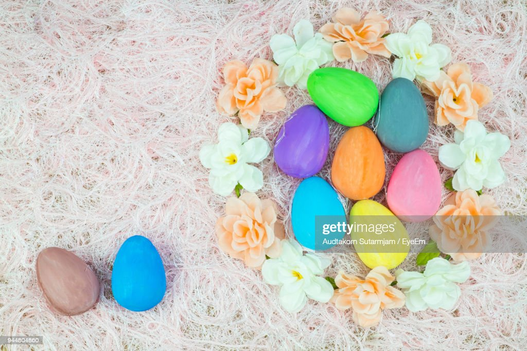 High Angle View Of Colorful Easter Eggs With Flowers On Rug : Stock Photo