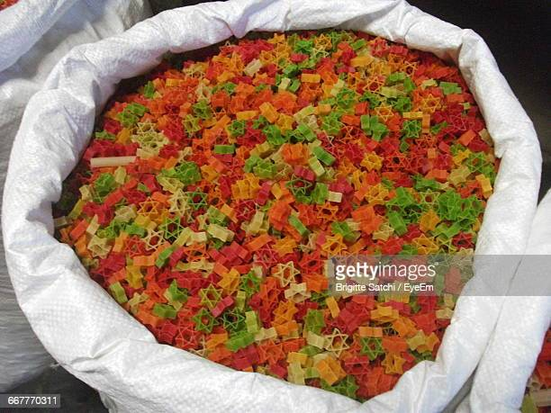 High Angle View Of Colorful Fryums In Sack At Market Stall