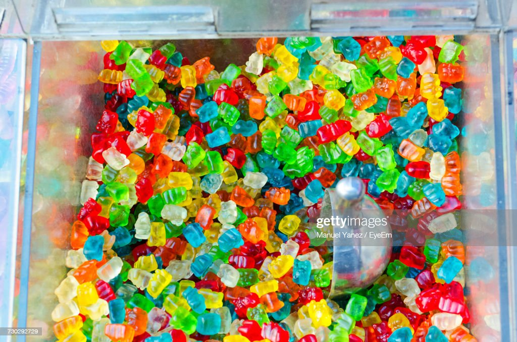 High Angle View Of Colorful Gummi Bears In Glass Container For Sale : Stock Photo