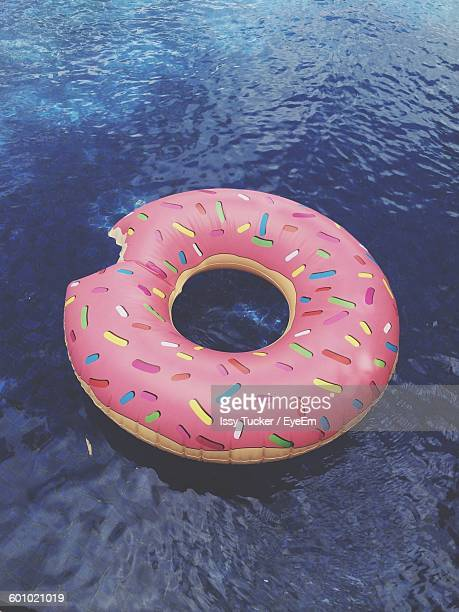 High Angle View Of Colorful Inflatable Ring On Water