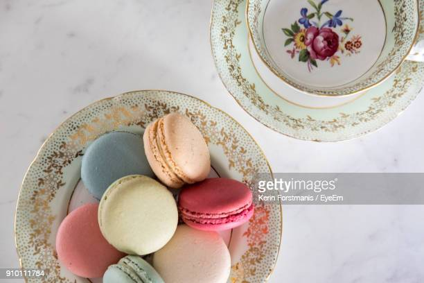 High Angle View Of Colorful Macaroons In Plate On Table