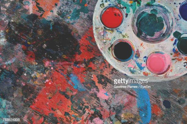 High Angle View Of Colorful Palette On Stained Wooden Table