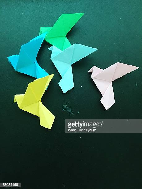 High Angle View Of Colorful Paper Cranes On Table