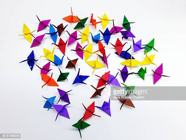 High Angle View Of Colorful Paper Cranes On White Background