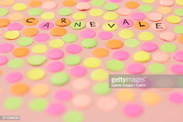 High Angle View Of Colorful Papers With Text Arranged On Table