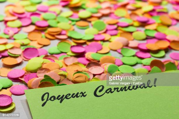High Angle View Of Colorful Papers With Text On Table