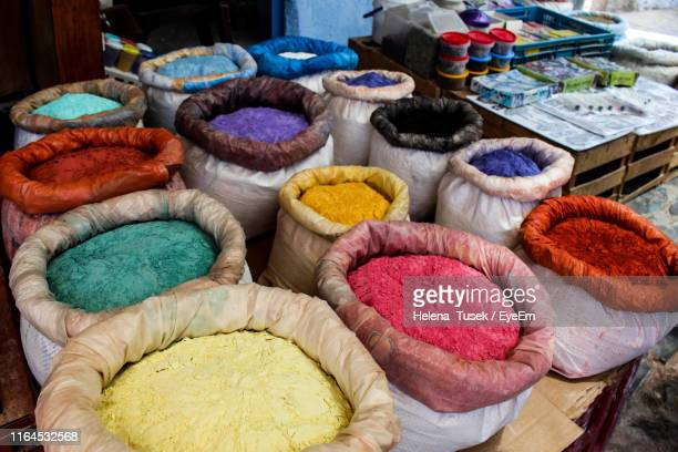 high angle view of colorful powder paints for sale at market - helena price stock-fotos und bilder