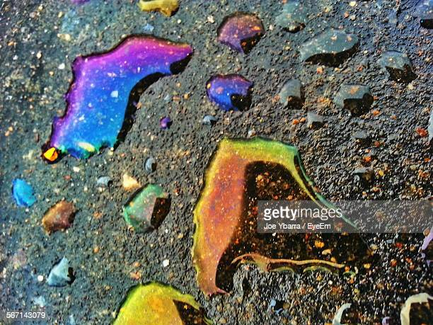 High Angle View Of Colorful Spilled Oil On Street