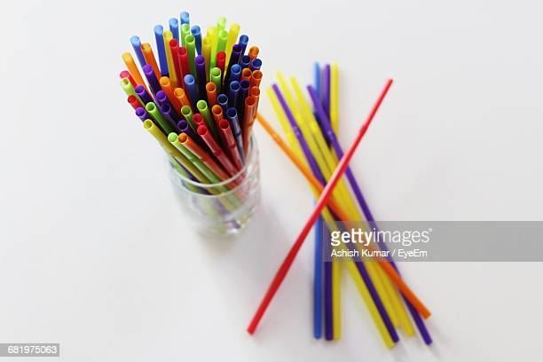 High Angle View Of Colorful Straws On White Background