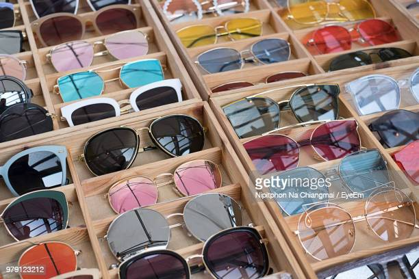 high angle view of colorful sunglasses for sale in store - eyeem collection stock pictures, royalty-free photos & images