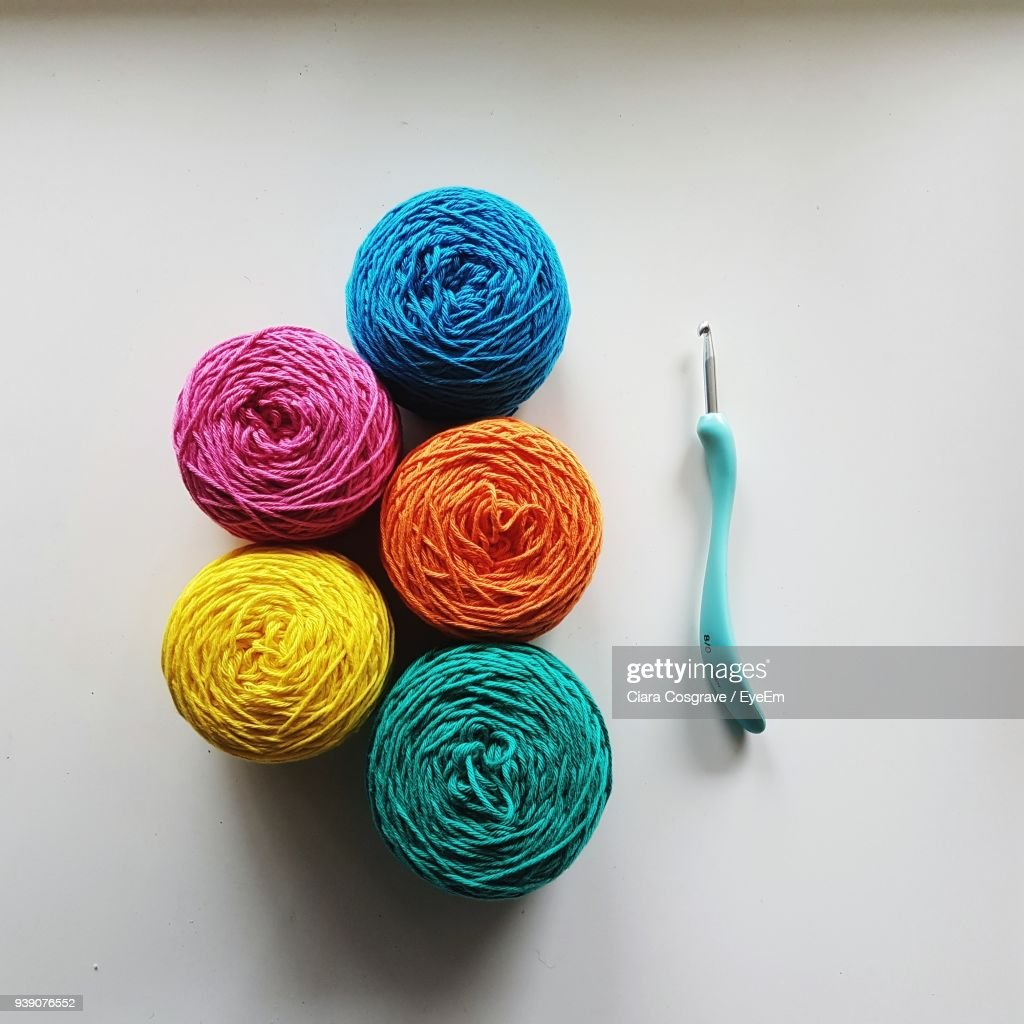 High Angle View Of Colorful Wools And Knitting Needle On Table : Stock Photo