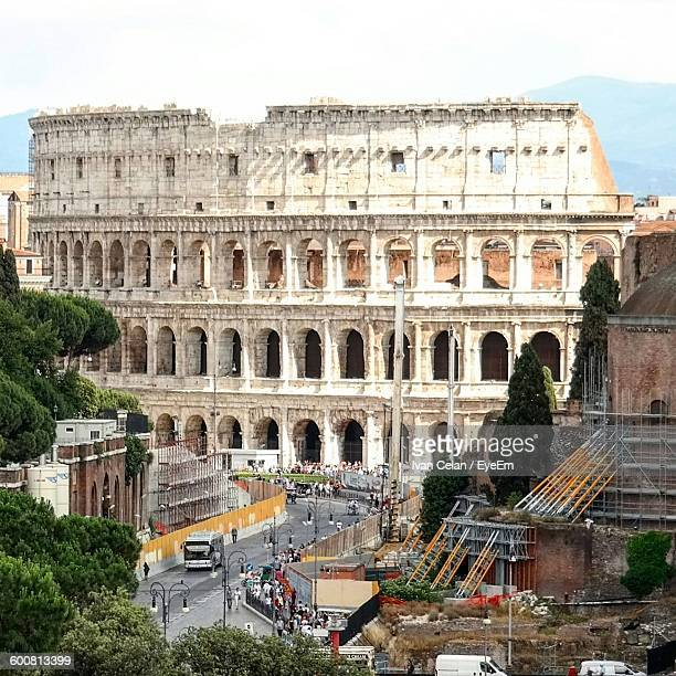 High Angle View Of Colosseum In City Against Sky