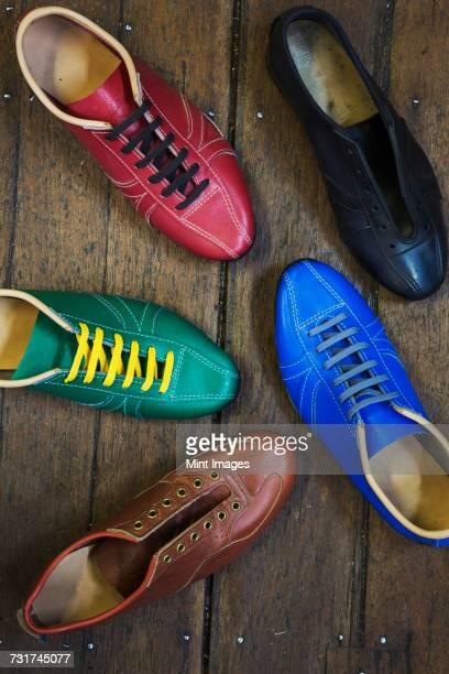 High angle view of colourful leather shoes in a shoemakers workshop.