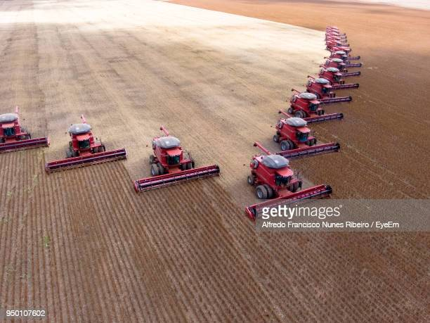 High Angle View Of Combine Harvesters On Field