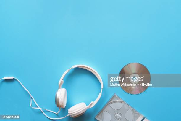high angle view of compact disc and headphones on table - compact disc stock pictures, royalty-free photos & images