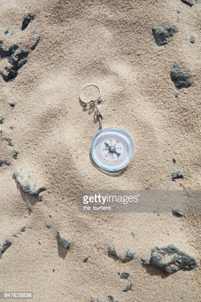 High angle view of compass on the beach