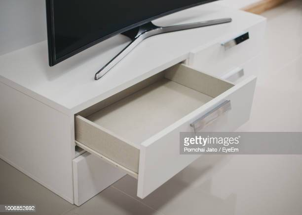high angle view of computer on drawers at home - drawer stock pictures, royalty-free photos & images