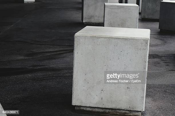 high angle view of concrete blocks on asphalt - block shape stock pictures, royalty-free photos & images