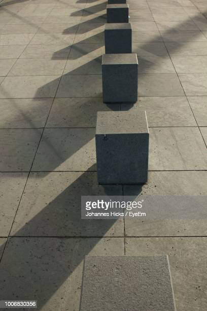 High Angle View Of Concrete Blocks On Footpath