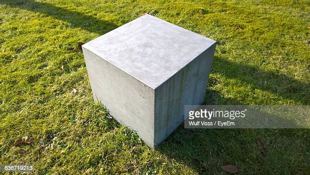 High Angle View Of Concrete Structure On Grassy Field