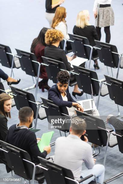 high angle view of conference audience - attending stock pictures, royalty-free photos & images