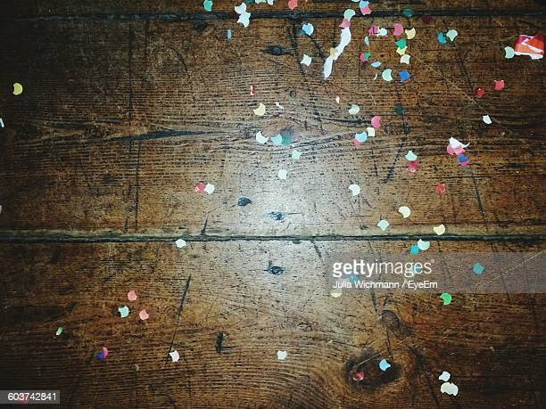 High Angle View Of Confetti On Wooden Table