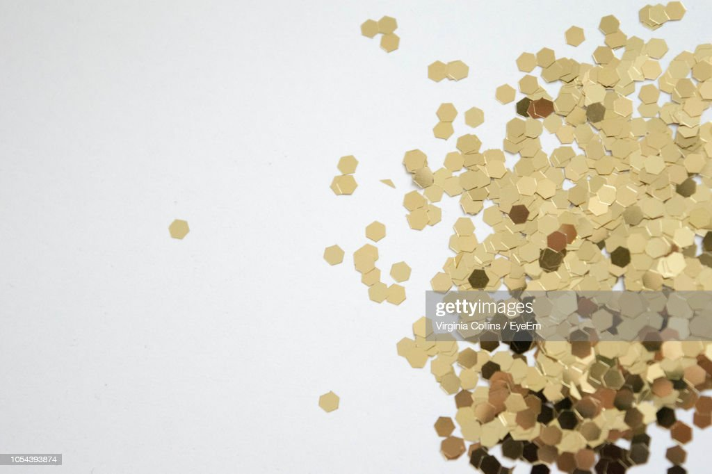High Angle View Of Confetti Over White Background : Stock-Foto