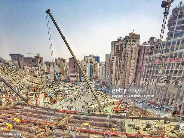 high angle view of construction site against buildings in city - mecca stock photos and pictures