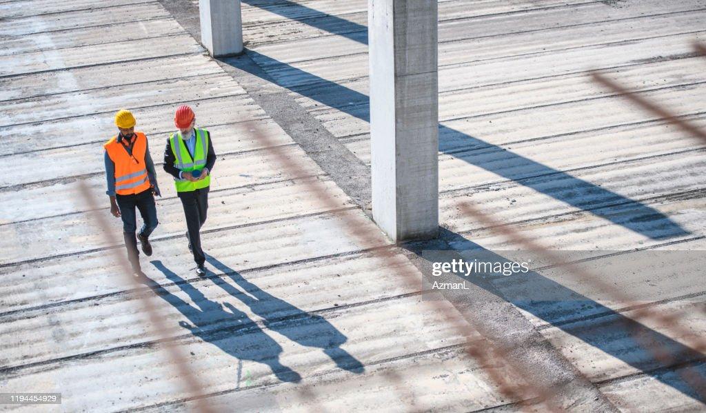 High Angle view van bouwplaats collega's : Stockfoto