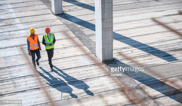 high angle view of construction site colleagues - construction industry stock pictures, royalty-free photos & images