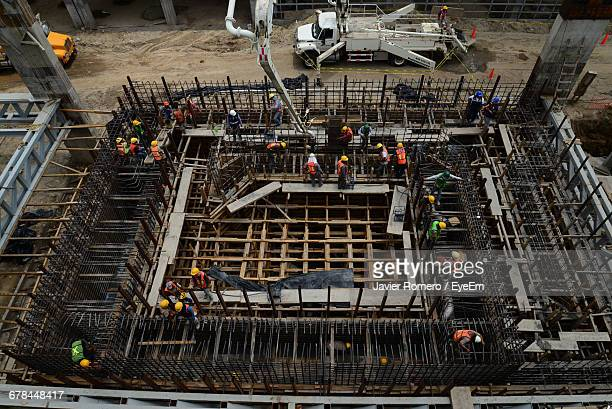 high angle view of construction workers at site - build grill stock photos and pictures