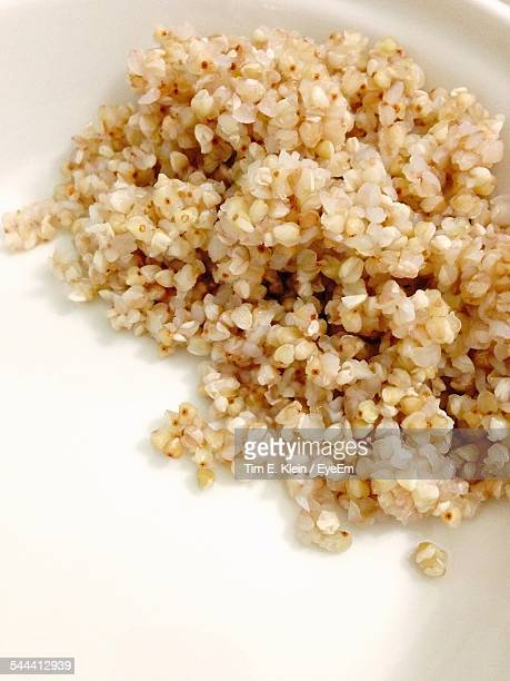High Angle View Of Cooked Buckwheat On White Plate