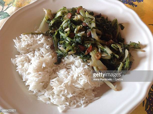 High Angle View Of Cooked Vegetables With Rice In Plate
