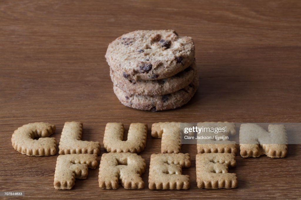 High Angle View Of Cookies Arranged As Gluten Free On Table : Stock Photo