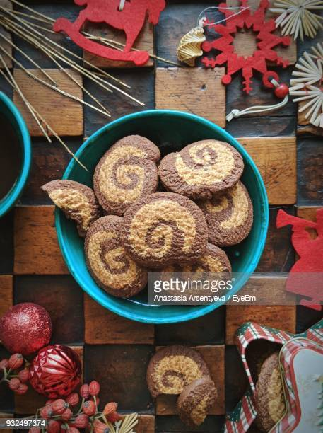 High Angle View Of Cookies In Bowl With Christmas Decoration On Table