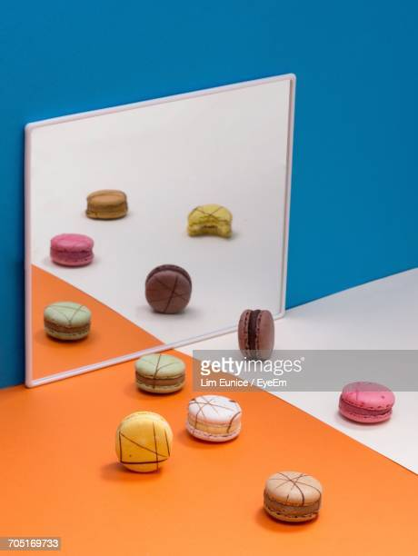 High Angle View Of Cookies Over Colored Background