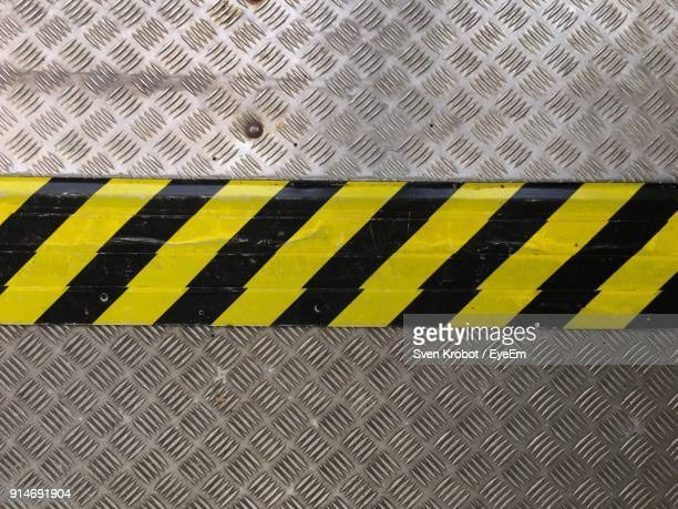 high angle view of cordon tape - danger stock photos and pictures