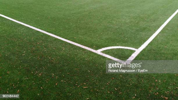 high angle view of corner marking on soccer field - corner stock photos and pictures