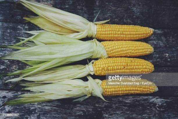 High Angle View Of Corns On Wooden Table