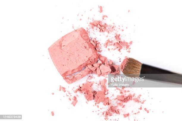 high angle view of cosmetic powder with brush - アイシャドウ ストックフォトと画像