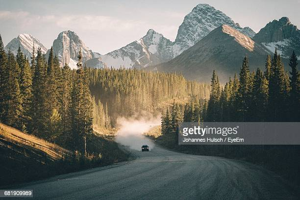 high angle view of country road leading to mountains - extreme terrain stock pictures, royalty-free photos & images